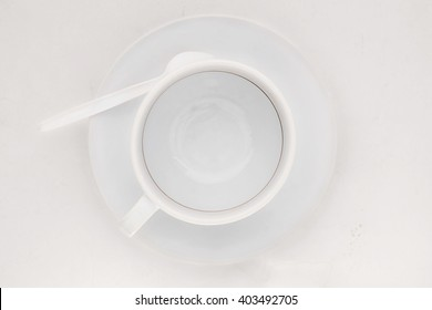 Empty coffee cup with coffee stains on white background. Top view.