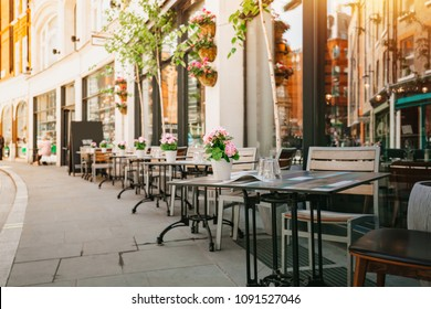 Empty coffee and restaurant terrace with tables and chairs in london indie and hipster style