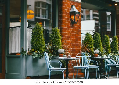 Empty coffee and restaurant terrace with tables and chairs in london sunset