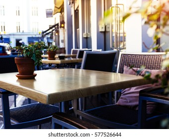 Empty coffee and restaurant terrace with tables and chairs london sunset
