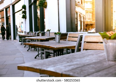 Empty coffee and restaurant terrace with tables and chairs londo