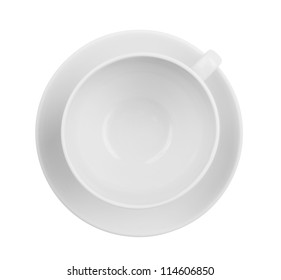 Empty coffee or tea cup top view isolated. Whole cup and saucer are both in focus.