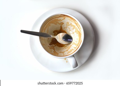 Empty of coffee in the white cup.