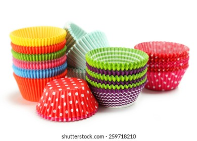 Empty colorful cupcake cases isolated on white