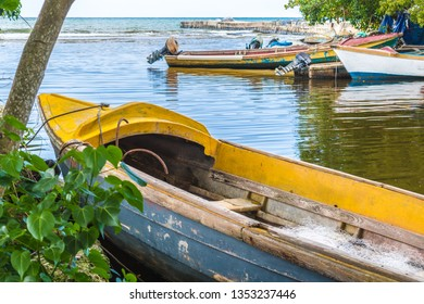 Empty colorful fishing boats on river bank