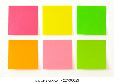 Empty colorful post its on the wall.