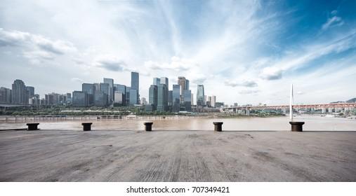 empty concrete floor and cityscape of hangzhou in cloud sky
