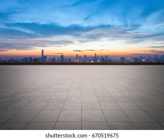 empty concrete floor with cityscape and skyline in sunset, bangkok, thailand.