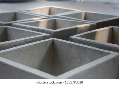 Empty concrete gray pots for plant. Modern geometric concrete design. Pot for home decoration.