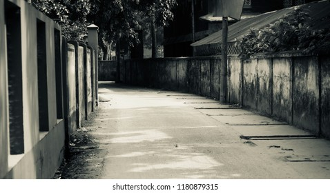 An empty concrete road in an urban area isolated unique photo