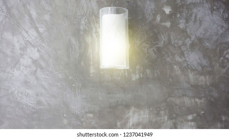 Empty concrete room wall and glowing lamps