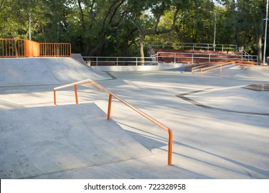 Empty concrete skatepark plaza background