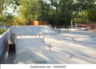 Empty concrete skatepark plaza background