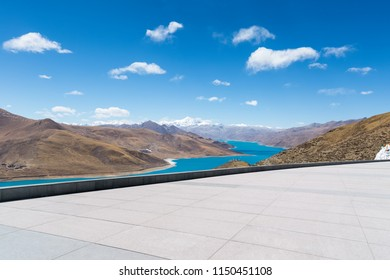 empty concrete square floor and tibet holy lake landscape