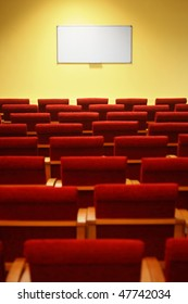 empty conference hall. rows of a chairs. focus on a screen