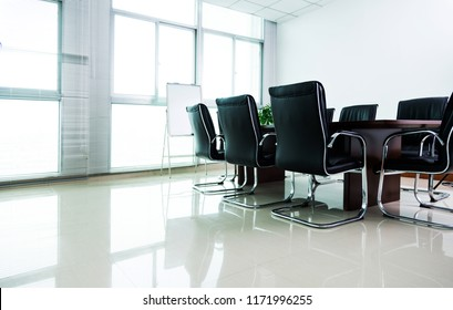 Empty conference room with table and chairs