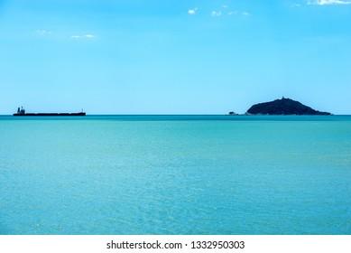 Empty container ship, in the Mediterranean Sea with the Tino and Tinetto island in the Gulf of La Spezia, Liguria, italy, Europe