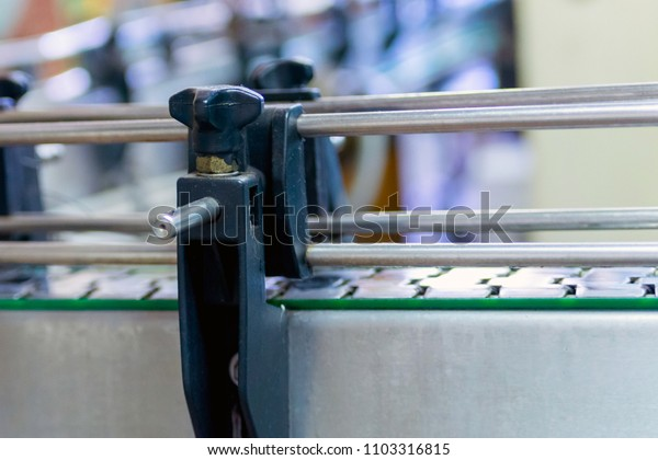 Empty conveyor line at modern winery