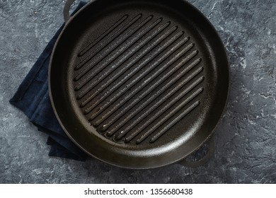 Empty cooking grill pan on dark background top view
