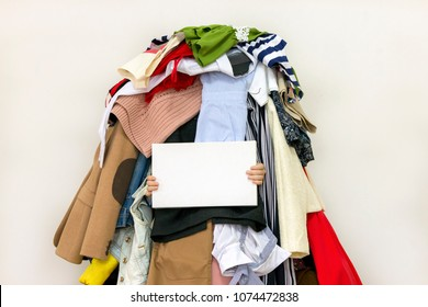Empty copy space on the board with pile of messy clothing on the background