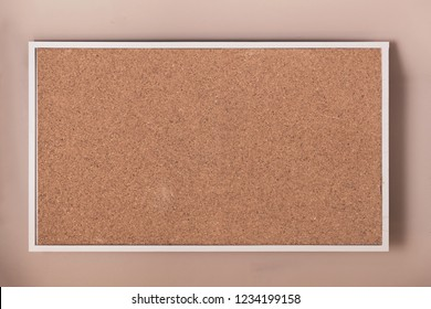 Empty cork board with frame background texture.