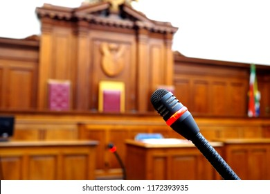 Empty courtroom, with old wooden panelling