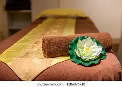 Empty cozy room with mat with white towel for thai massage