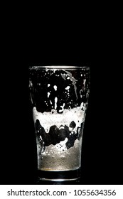 empty craft beer glass on black background