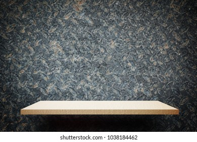 Empty Creamy wooden shelf on rustic metal wall for product display