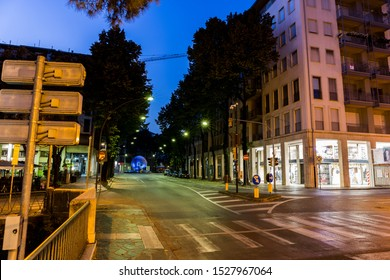 Empty crossroad with street lights at night. Treviso Italy