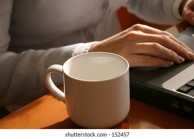 empty cup beside a home worker