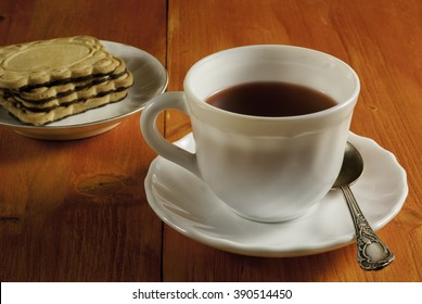 empty Cup and cookies on wooden background