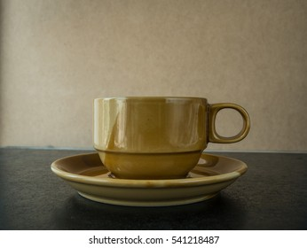 Empty cup on black background,