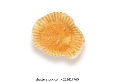 Empty cupcake bun wrapper isolated on white with clipping path, shot from above