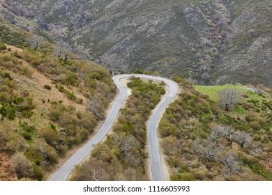 Empty curved asphalt mountain road. Rural scenic travel. Horizontal