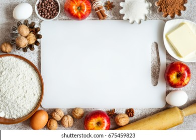 empty cutting board and Ingredients for baking with apples and spices