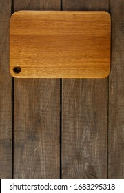 empty cutting board on wooden surface