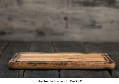 Empty cutting board on a wooden table close up