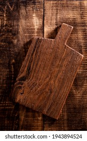 Empty Cutting Chopping Board on Old Rustik Table For Can Be Used For Food Cake, Bakery Background Photo