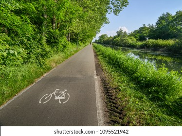 Empty cycling path along the Naviglio Pavese, canal which stretches for 30km from Pavia to Milan in Lombardy, northern Italy