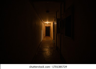 Empty dark corridor with light at the end.
