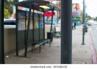 Empty Dark Gray Metal Pole in front of a Bus Stop