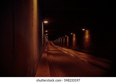 empty dark tunnel road under earth, deserted way