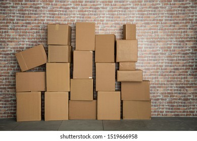 Empty deposit with a a lot of boxes with a Brick wall. Copy Space.