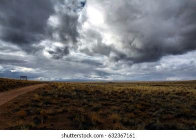 Empty desert beneath dramatic sky. Petroglyph National Monument, Albuquerque, New Mexico.