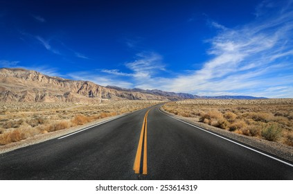 An empty desert road on the way to Death Valley National Park