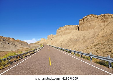 Empty deserted highway in USA, travel background with copy space.
