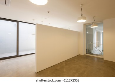 empty design office with window, lighting, white wall at the daylight.