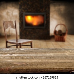 empty desk chair and fireplace