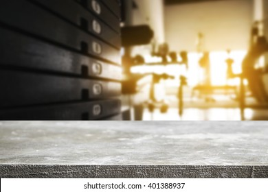Empty desk space platform and fitness gym background with weight stack. For product display montage.